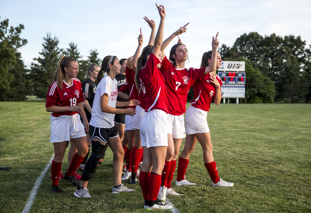 Glenwood's Maddie Klintworth (7) and her teammates begin to celebrate as the buzzer sounds on their 5-1 victory over Metamora in the Class 2A Springfield Supersectional at Kiwanis Stadium, Tuesday, June 2, 2015, in Springfield, Ill. Justin L. Fowler/The State Journal-Register