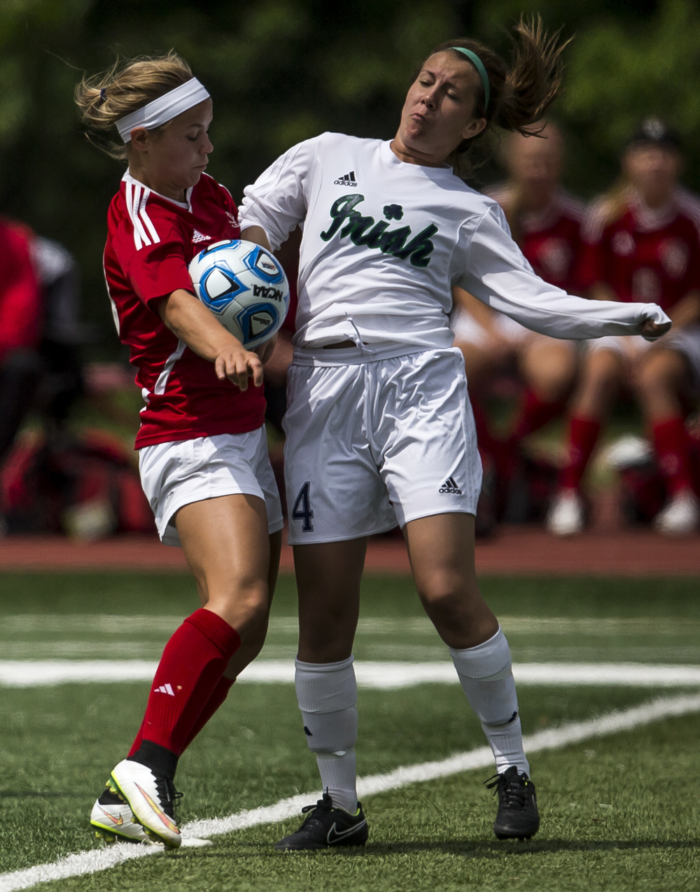 Glenwood's Kelly Graves (10) battles for possession of the ball against Peoria Notre Dame's Kristen Slomba (9) in the first half during the IHSA Class 2A Girls State Soccer Semifinals at North Central College, Friday, June 5, 2015, in Naperville, Ill. Justin L. Fowler/The State Journal-Register