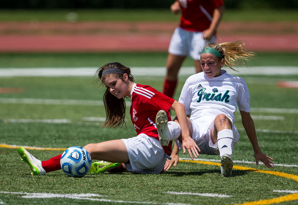 Glenwood's Maddie Klintworth (7) is brought down by Peoria Notre Dame's Elizabeth Mills (10) as they both went for the ball in the second half during the IHSA Class 2A Girls State Soccer Semifinals at North Central College, Friday, June 5, 2015, in Naperville, Ill. Justin L. Fowler/The State Journal-Register