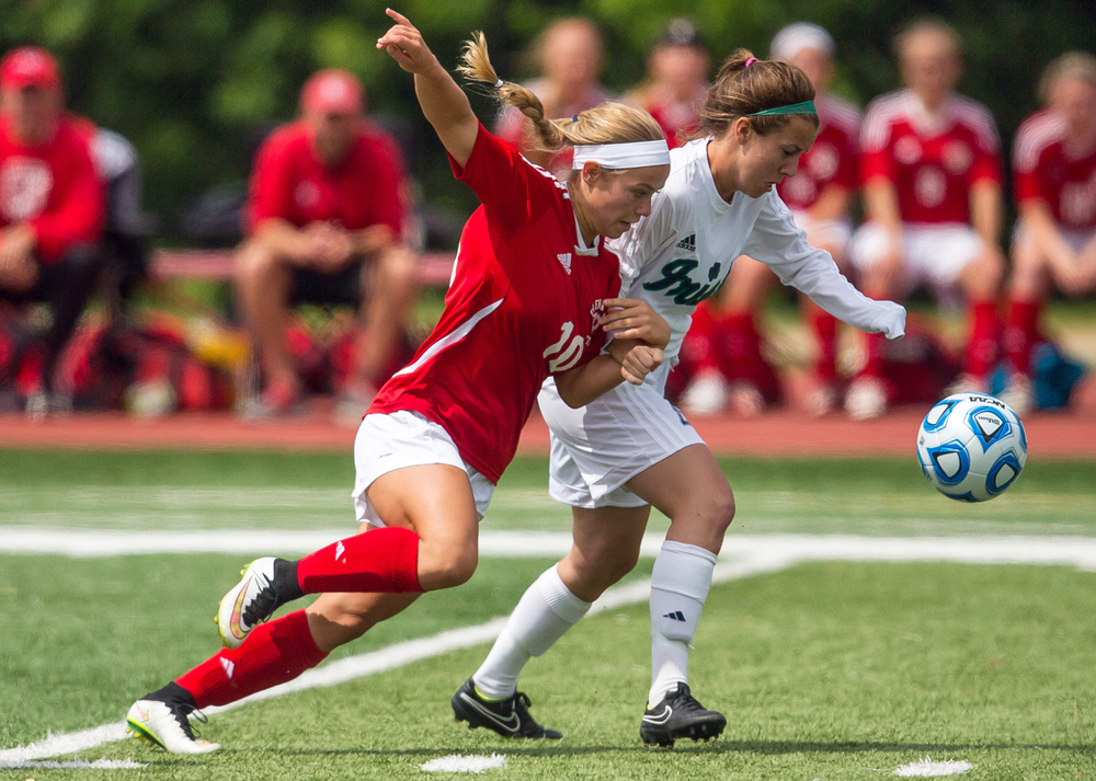 Glenwood's Kelly Graves (10) battles with Peoria Notre Dame's Liz Frampton (4) for possession of the ball in the first half during the IHSA Class 2A Girls State Soccer Semifinals at North Central College, Friday, June 5, 2015, in Naperville, Ill. Justin L. Fowler/The State Journal-Register