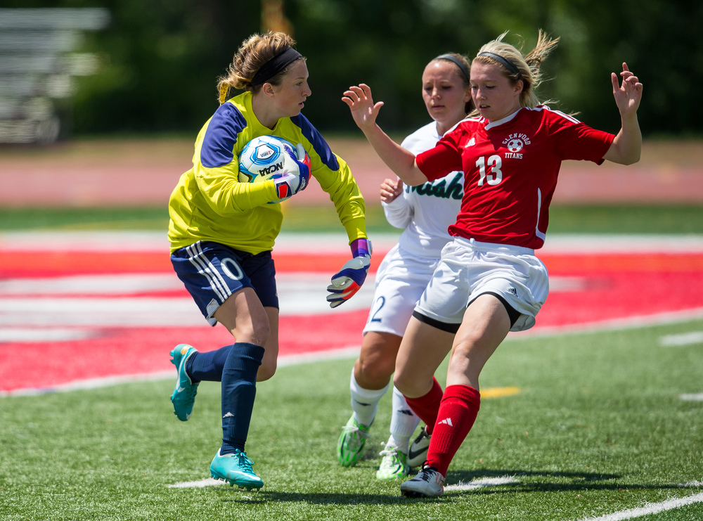 Peoria Notre Dame goal keeper Jenna Ashley (0) snags the ball up in front of Glenwood's Alyssa Moriconi (13) in the second half during the IHSA Class 2A Girls State Soccer Semifinals at North Central College, Friday, June 5, 2015, in Naperville, Ill. Justin L. Fowler/The State Journal-Register