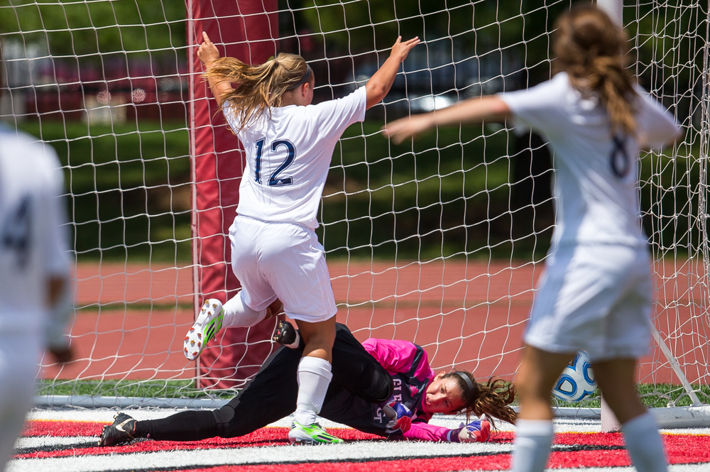 Peoria Notre Dame's Kahla Walker (12) kicks in a goal against Glenwood goal keeper Madlyn Lawrence in the second half during the IHSA Class 2A Girls State Soccer Semifinals at North Central College, Friday, June 5, 2015, in Naperville, Ill. Justin L. Fowler/The State Journal-Register