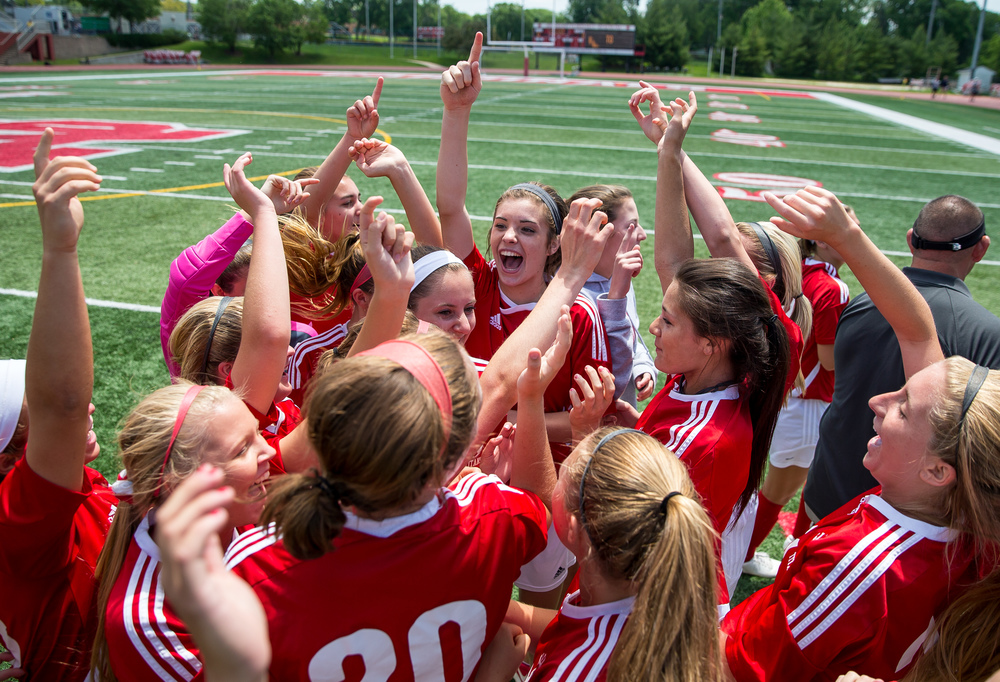 Glenwood's Maddie Klintworth (7) and the Titans celebrate after defeating Peoria Notre Dame 4-1 the IHSA Class 2A Girls State Soccer Semifinals at North Central College, Friday, June 5, 2015, in Naperville, Ill. Justin L. Fowler/The State Journal-Register