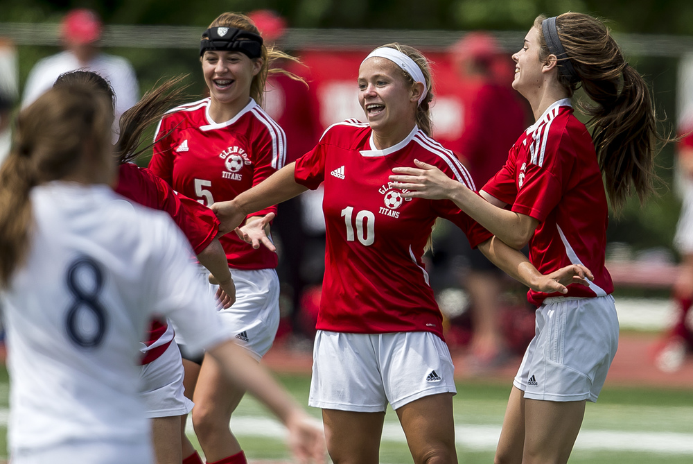 Glenwood's Kelly Graves (10) celebrates a goal with Rachel Mays (5) and Maddie Klintworth (7) against Peoria Notre Dame to make it 1-0 in the first half during the IHSA Class 2A Girls State Soccer Semifinals at North Central College, Friday, June 5, 2015, in Naperville, Ill. Justin L. Fowler/The State Journal-Register