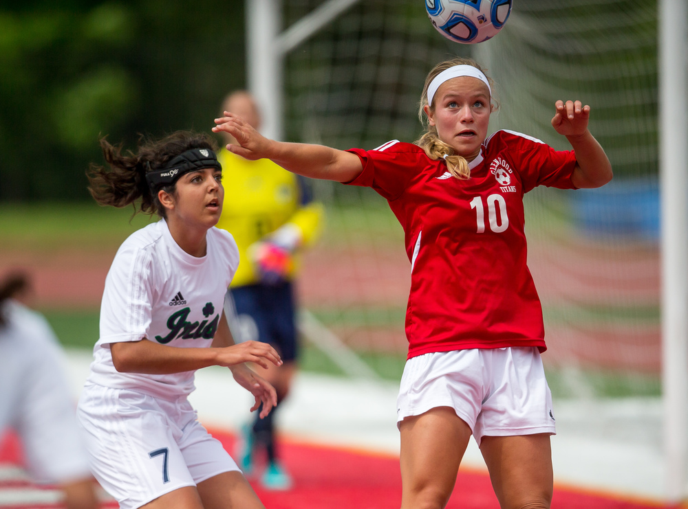 Glenwood's Kelly Graves (10) eyes a header over Peoria Notre Dame's Elizabeth Shealy (7) in the first half during the IHSA Class 2A Girls State Soccer Semifinals at North Central College, Friday, June 5, 2015, in Naperville, Ill. Justin L. Fowler/The State Journal-Register