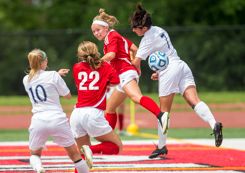 Glenwood's Kelly Graves (10) flies through the air as she tries to smack a header into the goal off a corner kick against Peoria Notre Dame's Elizabeth Shealy (7)  in the first half during the IHSA Class 2A Girls State Soccer Semifinals at North Central College, Friday, June 5, 2015, in Naperville, Ill. Justin L. Fowler/The State Journal-Register