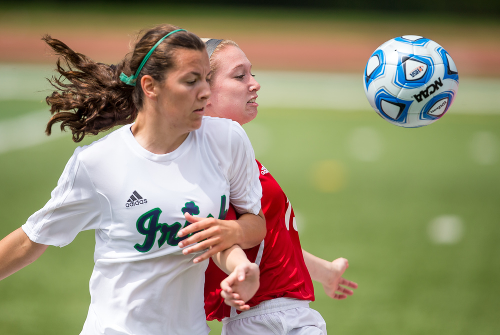 Glenwood's Alyssa Moriconi (13) fights for possession against Peoria Notre Dame's Kiele Anderson (14)  in the first half during the IHSA Class 2A Girls State Soccer Semifinals at North Central College, Friday, June 5, 2015, in Naperville, Ill. Justin L. Fowler/The State Journal-Register