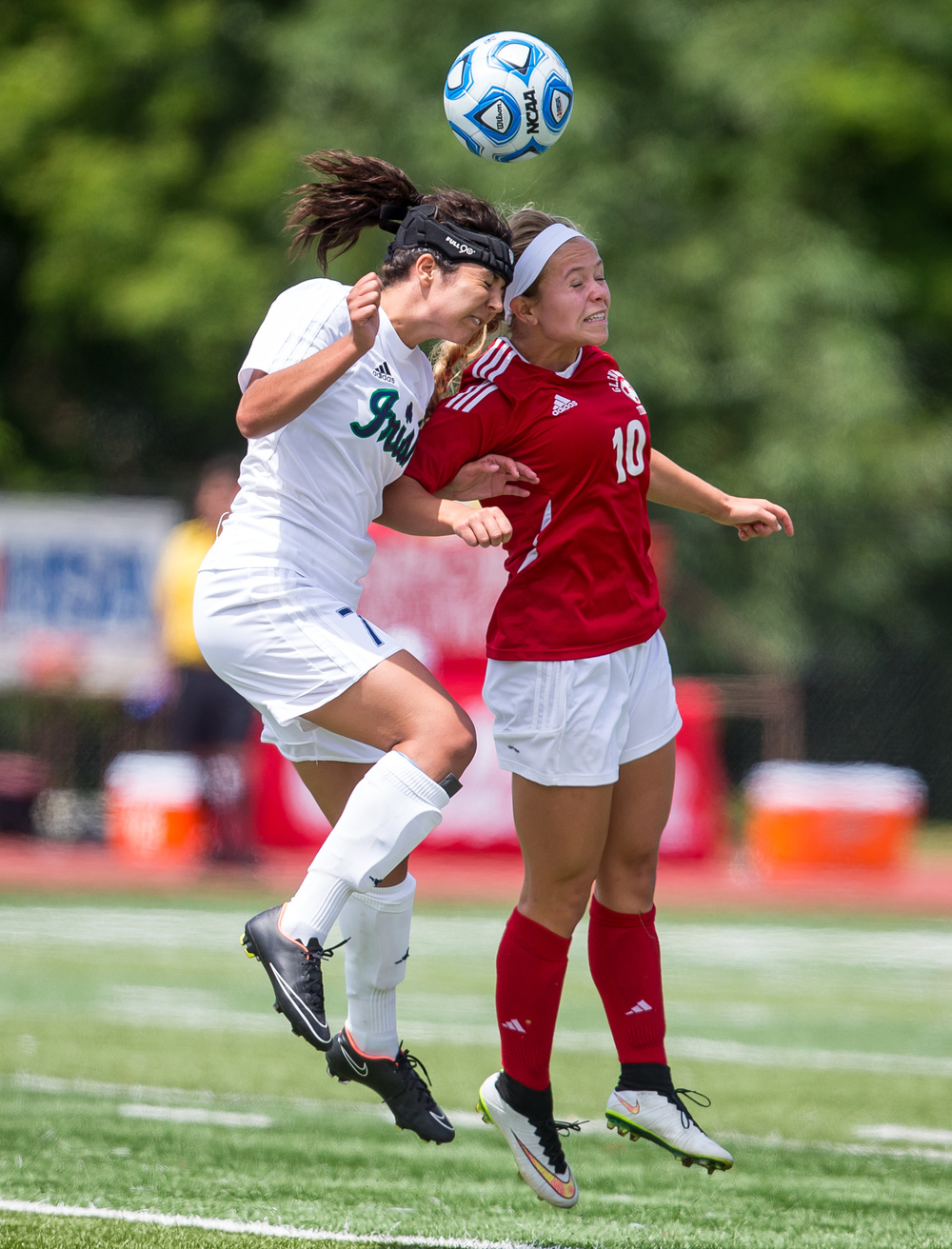 Glenwood's Kelly Graves (10) goes for a header against Peoria Notre Dame's Elizabeth Shealy (7) in the second half during the IHSA Class 2A Girls State Soccer Semifinals at North Central College, Friday, June 5, 2015, in Naperville, Ill. Justin L. Fowler/The State Journal-Register