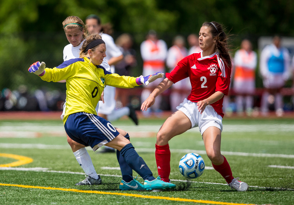 Peoria Notre Dame goal keeper Jenna Ashley (0) kicks away a scoring opportunity for Glenwood's Taylor Parriott (2) in the second half during the IHSA Class 2A Girls State Soccer Semifinals at North Central College, Friday, June 5, 2015, in Naperville, Ill. Justin L. Fowler/The State Journal-Register