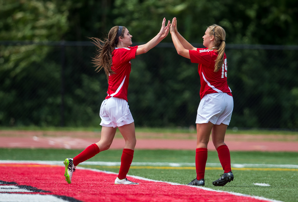 Glenwood's Maddie Klintworth (7) gets high fives from Madison Volpert (19) after scoring a goal to make it 2-0 Titans over Peoria Notre Dame in the second half during the IHSA Class 2A Girls State Soccer Semifinals at North Central College, Friday, June 5, 2015, in Naperville, Ill. Justin L. Fowler/The State Journal-Register