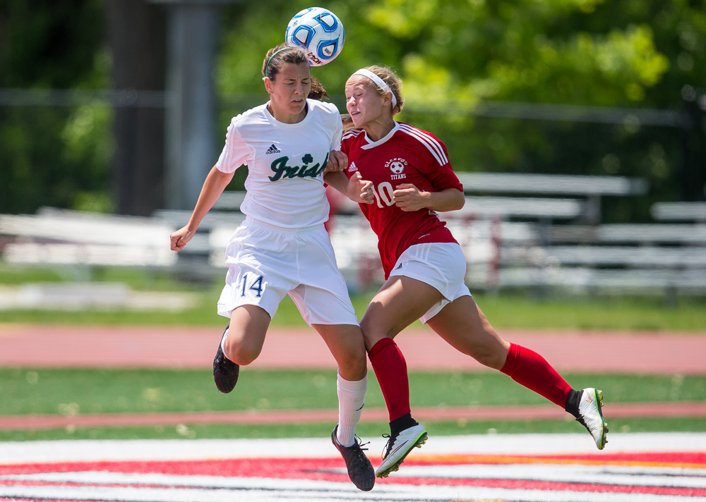 Glenwood's Kelly Graves (10) goes for a header in front of the goal against Peoria Notre Dame's Kiele Anderson (14) in the second half during the IHSA Class 2A Girls State Soccer Semifinals at North Central College, Friday, June 5, 2015, in Naperville, Ill. Justin L. Fowler/The State Journal-Register