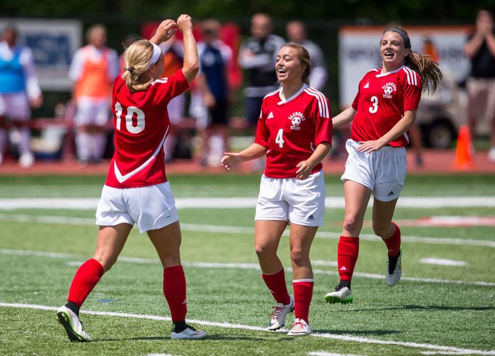 Glenwood's Kelly Graves (10) celebrates her second goal with Cayne Randle (4) and Katie Juhlin (3) to make it 3-0 against Peoria Notre Dame in the second half during the IHSA Class 2A Girls State Soccer Semifinals at North Central College, Friday, June 5, 2015, in Naperville, Ill. Justin L. Fowler/The State Journal-Register