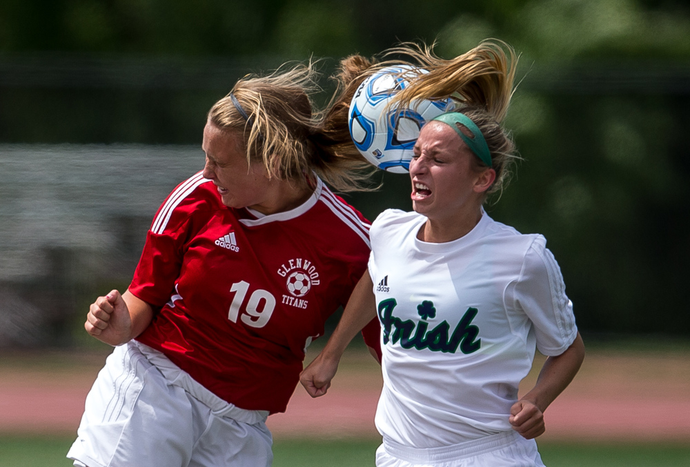 Glenwood's Madison Volpert (19) and Peoria Notre Dame's Elizabeth Mills (10) go for a header in the air in the first half during the IHSA Class 2A Girls State Soccer Semifinals at North Central College, Friday, June 5, 2015, in Naperville, Ill. Justin L. Fowler/The State Journal-Register