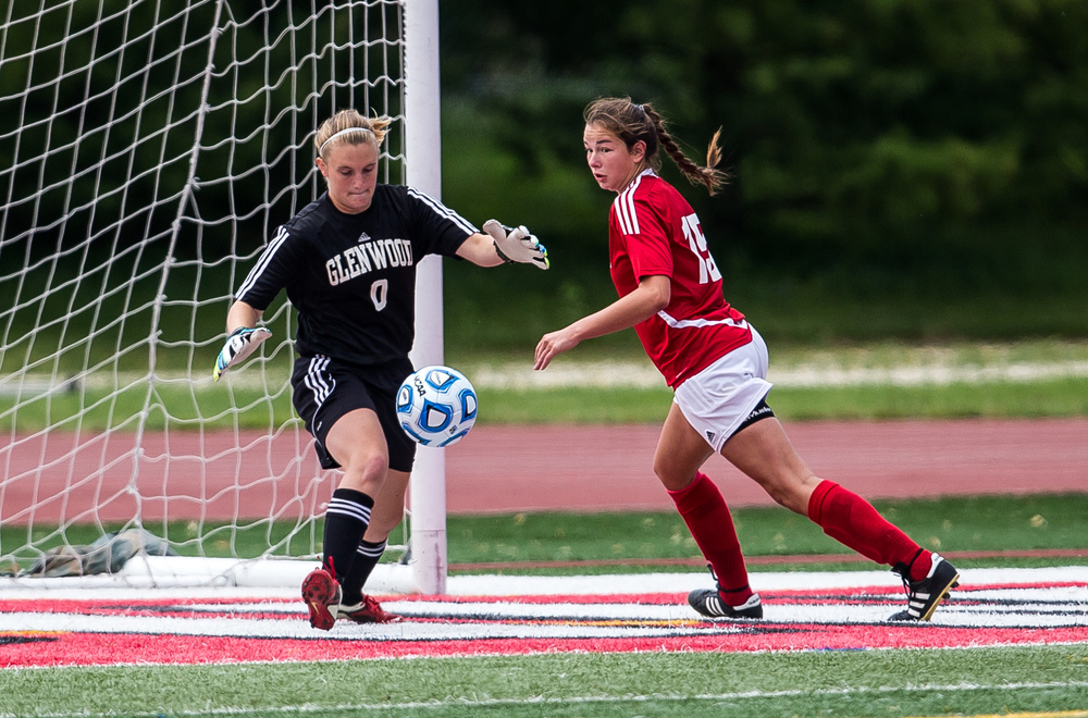 Glenwood goal keeper Mara Cunningham stops a shot in front of the net from Peoria Notre Dame in the first half during the IHSA Class 2A Girls State Soccer Semifinals at North Central College, Friday, June 5, 2015, in Naperville, Ill. Justin L. Fowler/The State Journal-Register