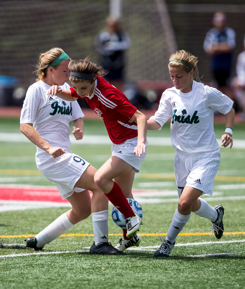 Glenwood's Maddie Klintworth (7) is double teamed by Peoria Notre Dame's Kristen Slomba (9) and Kenna Carew (17) as they try to steal the ball away in the first half during the IHSA Class 2A Girls State Soccer Semifinals at North Central College, Friday, June 5, 2015, in Naperville, Ill. Justin L. Fowler/The State Journal-Register