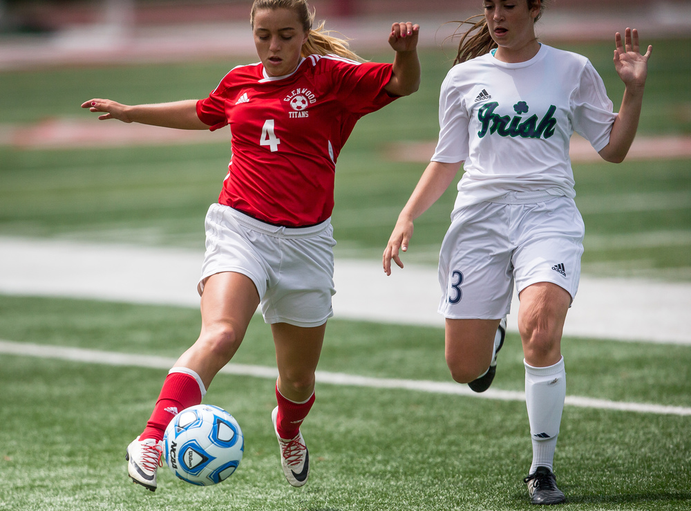 Glenwood's Cayne Randle (4) sends a ball downfield against Peoria Notre Dame's Bridget Schuler (13) in the first half during the IHSA Class 2A Girls State Soccer Semifinals at North Central College, Friday, June 5, 2015, in Naperville, Ill. Justin L. Fowler/The State Journal-Register