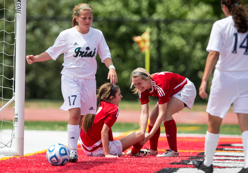 Glenwood's Alyssa Moriconi (13) comes to the aid of Maddie Klintworth (7) after she hit the ground coming down from scoring  goal against Peoria Notre Dame in the second half during the IHSA Class 2A Girls State Soccer Semifinals at North Central College, Friday, June 5, 2015, in Naperville, Ill. Justin L. Fowler/The State Journal-Register