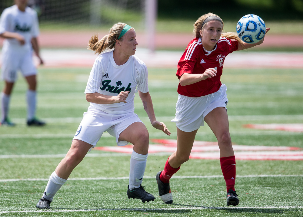 Glenwood's Kennedy Sheedy (21) goes for the ball against Peoria Notre Dame's Kristen Slomba (9) in the first half during the IHSA Class 2A Girls State Soccer Semifinals at North Central College, Friday, June 5, 2015, in Naperville, Ill. Justin L. Fowler/The State Journal-Register