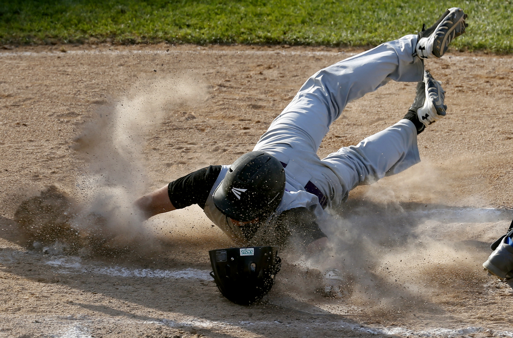 Williamsville's Talon File slides into home for the Bullets second run of the first inning against Teutopolis during the Class 2A Baseball Semifinals at Dozer Park in Peoria Friday, June 5, 2015. Ted Schurter/The State Journal-Register