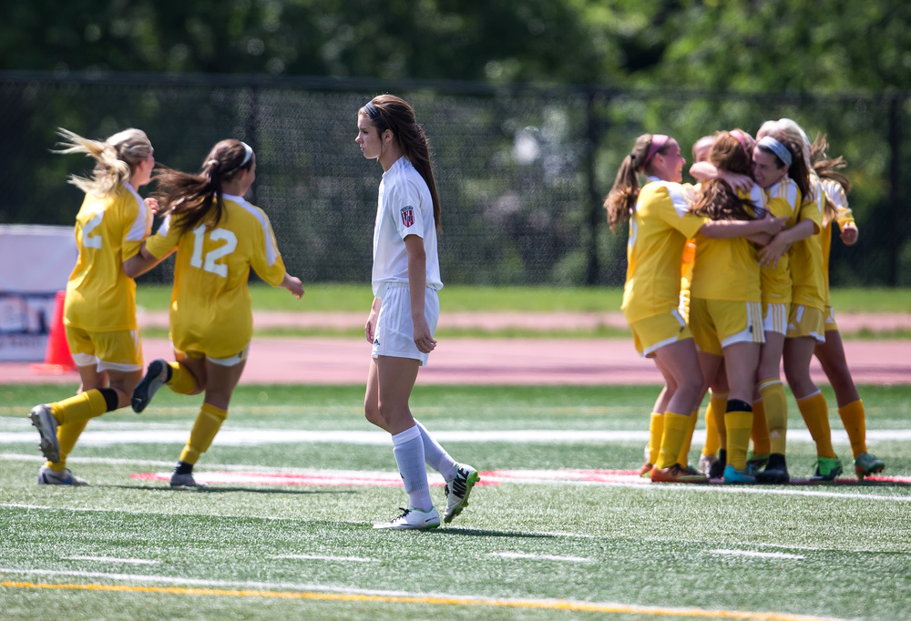 Glenwood's Maddie Klintworth (7) walks off the field as Mundelein Carmel celebrates their 1-0 victory over the Titans in the IHSA Class 2A Girls State Soccer Championship at North Central College, Saturday, June 6, 2015, in Naperville, Ill. Justin L. Fowler/The State Journal-Register