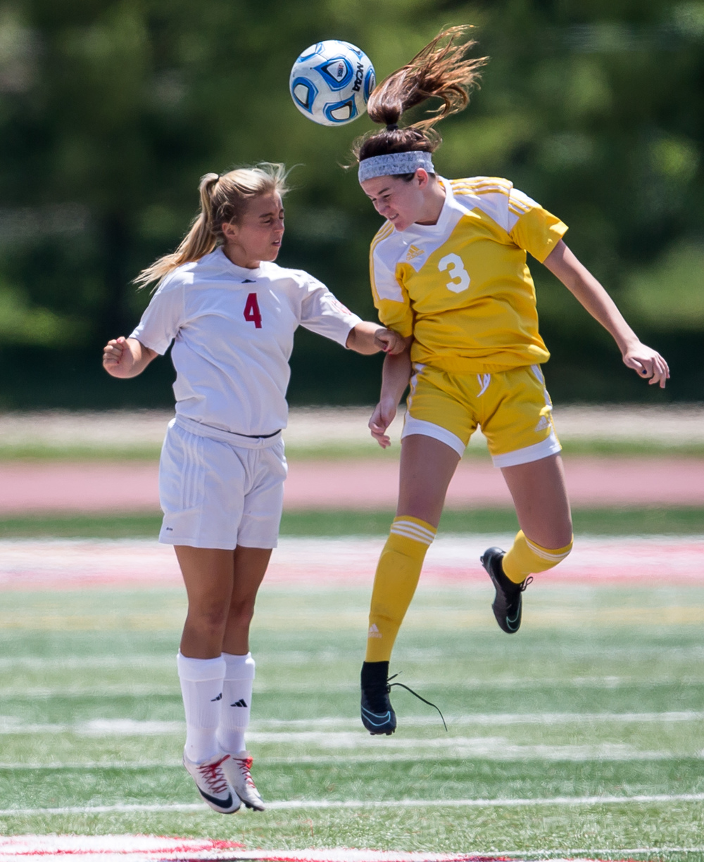 Mundelein Carmel's Erin Johnston (3) wins a header out of the air against Glenwood's Cayne Randle (4) in the first half during the IHSA Class 2A Girls State Soccer Championship at North Central College, Saturday, June 6, 2015, in Naperville, Ill. Justin L. Fowler/The State Journal-Register