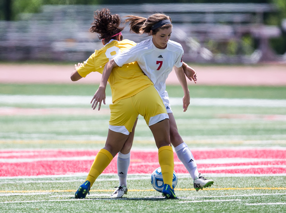 Glenwood's Maddie Klintworth (7) gets tangled up with Mundelein Carmel's Amanda Lasso (8) as they battle for the ball in the first half during the IHSA Class 2A Girls State Soccer Championship at North Central College, Saturday, June 6, 2015, in Naperville, Ill. Justin L. Fowler/The State Journal-Register