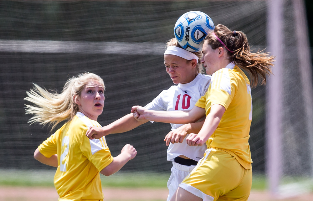 Glenwood's Kelly Graves (10) goes smacks a header against Mundelein Carmel's Mary Murphy (7) in the first half during the IHSA Class 2A Girls State Soccer Championship at North Central College, Saturday, June 6, 2015, in Naperville, Ill. Justin L. Fowler/The State Journal-Register