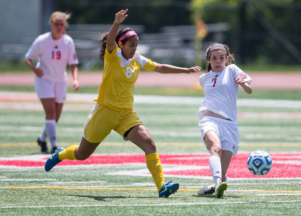 Glenwood's Maddie Klintworth (7) kicks the ball away from Mundelein Carmel's Amanda Lasso (8) in the first half during the IHSA Class 2A Girls State Soccer Championship at North Central College, Saturday, June 6, 2015, in Naperville, Ill. Justin L. Fowler/The State Journal-Register