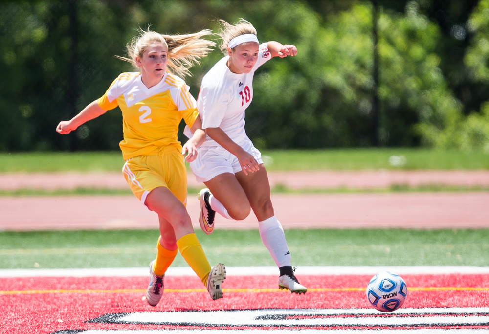 Glenwood's Kelly Graves (10) eyes a scoring opportunity as she advances the ball in front of Mundelein Carmel's Emma Kobitter (2) in the first half during the IHSA Class 2A Girls State Soccer Championship at North Central College, Saturday, June 6, 2015, in Naperville, Ill. Justin L. Fowler/The State Journal-Register