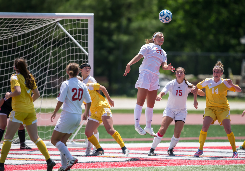 Glenwood's Maggie Juhlin (22) goes up to try and clear out a ball in front of the net against Mundelein Carmel in the first half during the IHSA Class 2A Girls State Soccer Championship at North Central College, Saturday, June 6, 2015, in Naperville, Ill. Justin L. Fowler/The State Journal-Register