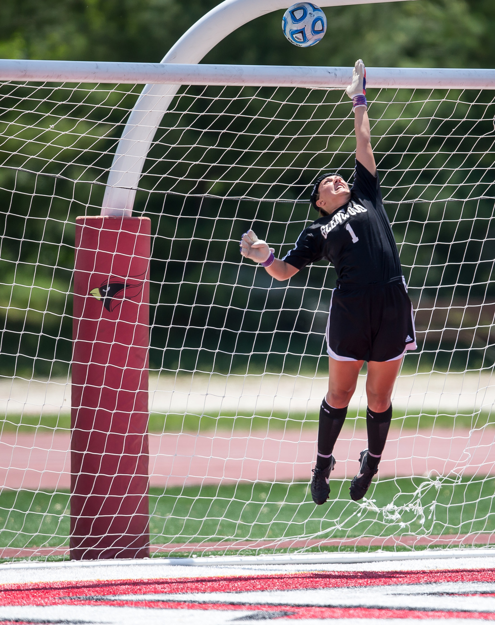 A shot from Mundelein Carmel sails over the top of the goal and Glenwood goal keeper Morgan Lauher (1) in the first half during the IHSA Class 2A Girls State Soccer Championship at North Central College, Saturday, June 6, 2015, in Naperville, Ill. Justin L. Fowler/The State Journal-Register