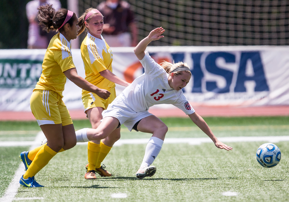 Glenwood's Alyssa Moriconi (13) is taken down by Mundelein Carmel's Megan Runyan (15) going for the ball in the first half during the IHSA Class 2A Girls State Soccer Championship at North Central College, Saturday, June 6, 2015, in Naperville, Ill. Justin L. Fowler/The State Journal-Register
