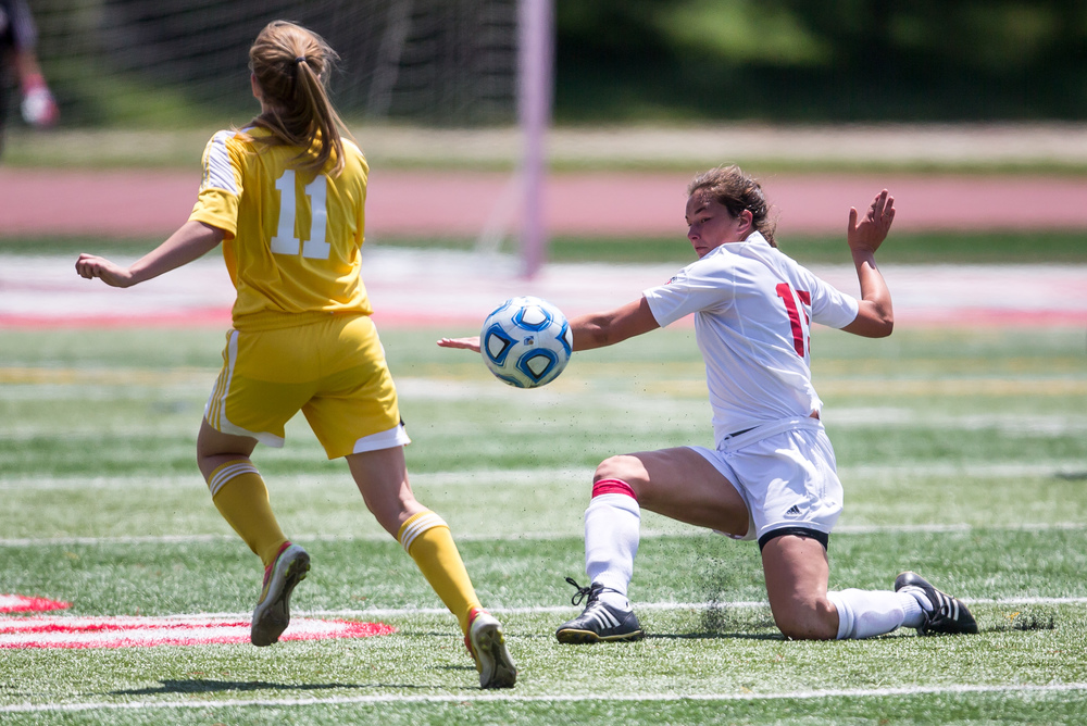 Glenwood's Alie Smith (15) clears a ball out in front Mundelein Carmel's MacKenzie Sheehan (11) in the first half during the IHSA Class 2A Girls State Soccer Championship at North Central College, Saturday, June 6, 2015, in Naperville, Ill. Justin L. Fowler/The State Journal-Register