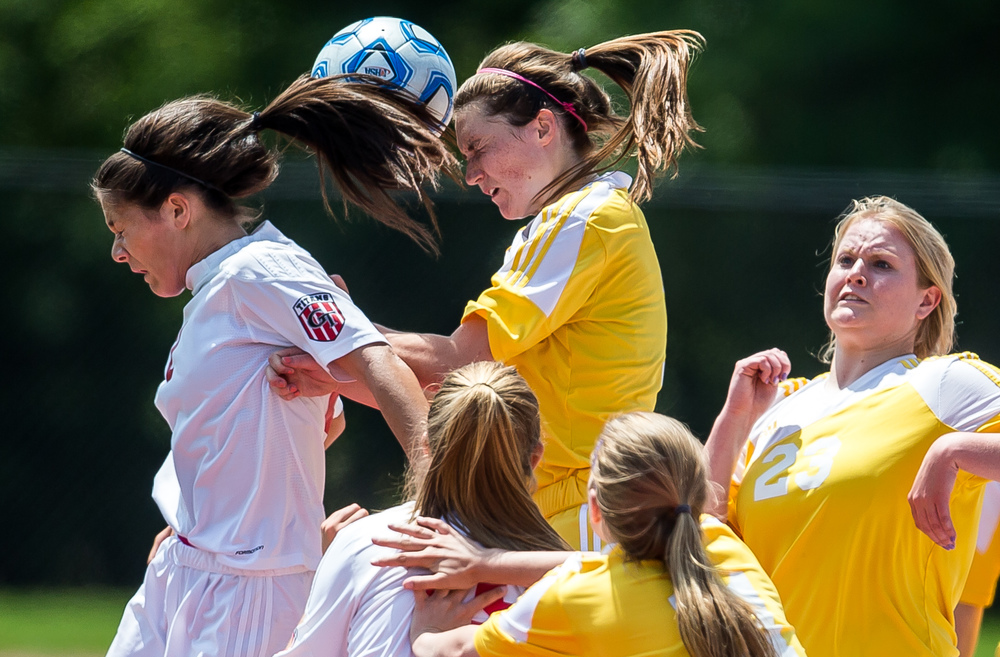 Glenwood's Taylor Parriott (2) and Mundelein Carmel's Mary Murphy (7) go for a header off a throw in from Glenwood's Maddie Klintworth (7) in the first half during the IHSA Class 2A Girls State Soccer Championship at North Central College, Saturday, June 6, 2015, in Naperville, Ill. Justin L. Fowler/The State Journal-Register