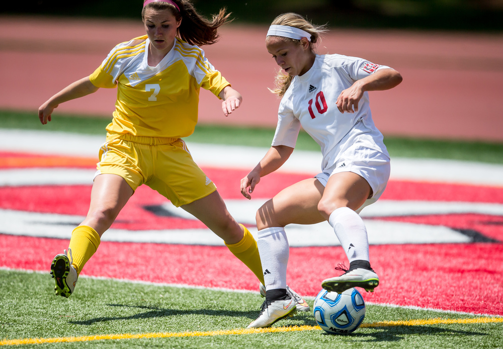 Glenwood's Kelly Graves (10) reverses directions on Mundelein Carmel's Mary Murphy (7) as she tries to move the ball towards the goal in the first half during the IHSA Class 2A Girls State Soccer Championship at North Central College, Saturday, June 6, 2015, in Naperville, Ill. Justin L. Fowler/The State Journal-Register