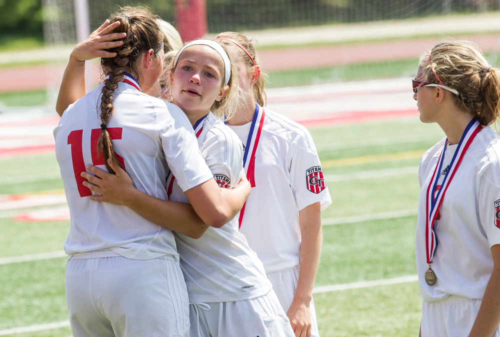 Glenwood's Kelly Graves (10) hugs Alie Smith (15) after the Titans 1-0 loss to Mundelein Carmel in the IHSA Class 2A Girls State Soccer Championship at North Central College, Saturday, June 6, 2015, in Naperville, Ill. Justin L. Fowler/The State Journal-Register