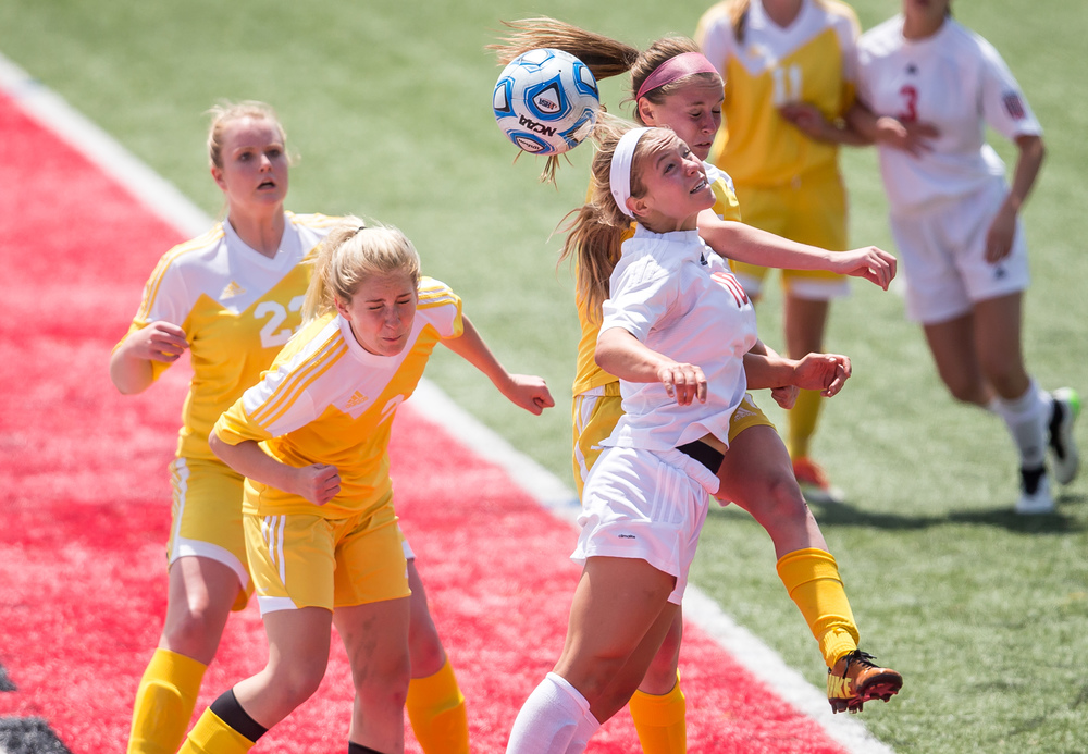 Glenwood's Kelly Graves (10) goes for a header against Mundelein Carmel's Megan Runyan (15) on a throw-in in the second half during the IHSA Class 2A Girls State Soccer Championship at North Central College, Saturday, June 6, 2015, in Naperville, Ill. Justin L. Fowler/The State Journal-Register