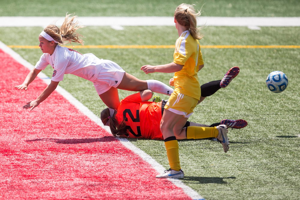 Glenwood's Kelly Graves (10) collides with Mundelein Carmel goal keeper Christina O'Block (22) after getting a shot off in the second half during the IHSA Class 2A Girls State Soccer Championship at North Central College, Saturday, June 6, 2015, in Naperville, Ill. Justin L. Fowler/The State Journal-Register