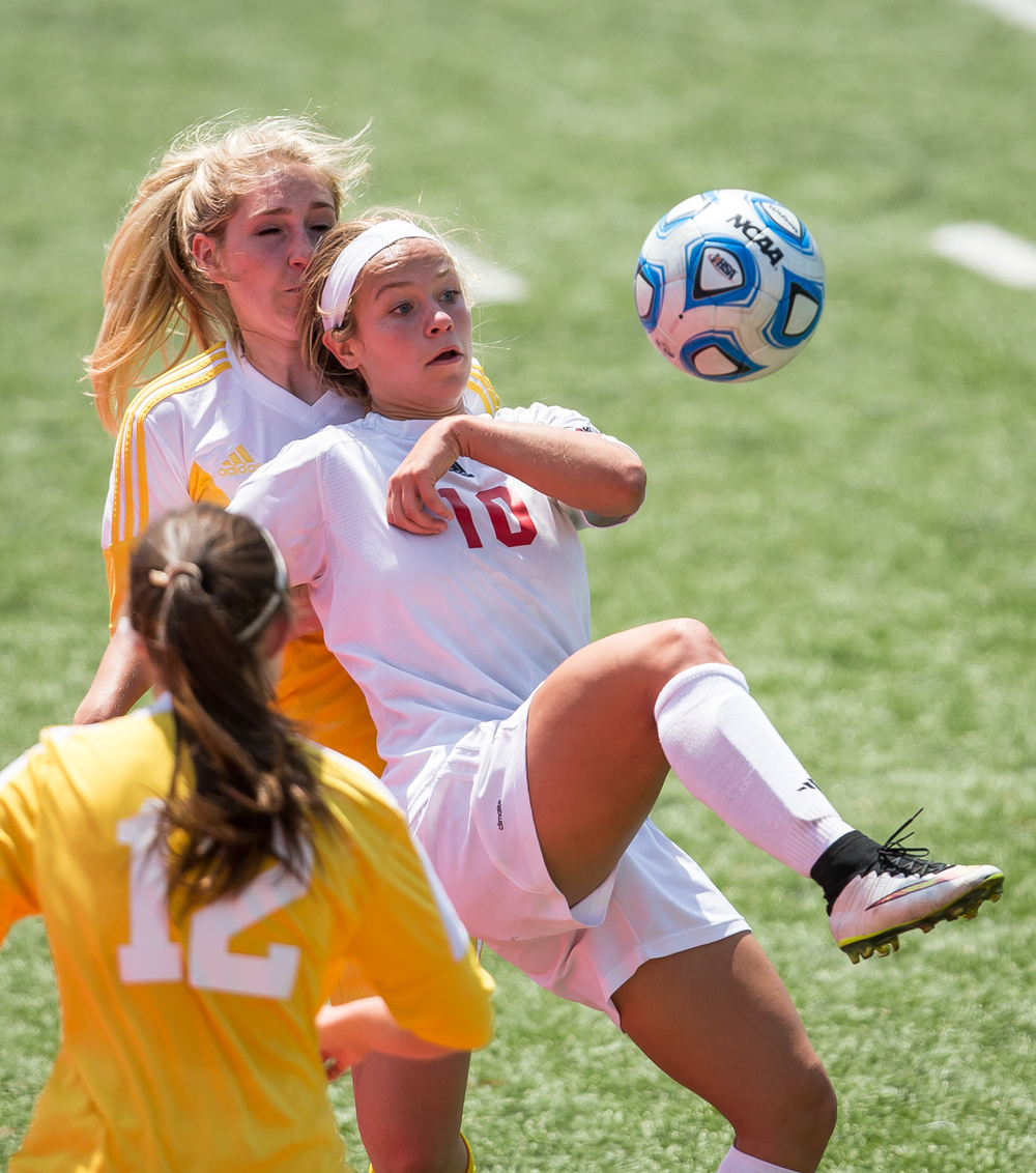 Glenwood's Kelly Graves (10) kicks the ball over the defense of Mundelein Carmel's Emma Kobitter (2) in the second half during the IHSA Class 2A Girls State Soccer Championship at North Central College, Saturday, June 6, 2015, in Naperville, Ill. Justin L. Fowler/The State Journal-Register