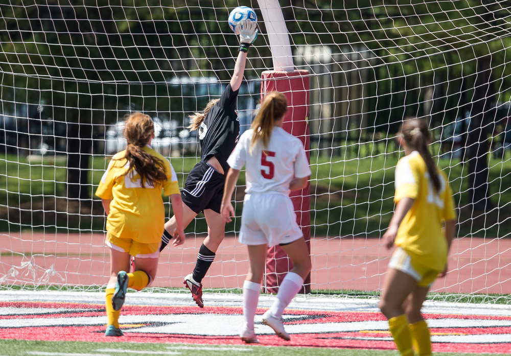 Glenwood goal keeper Mara Cunningham (0) leaps into the air trying to stop a goal from Mundelein Carmel to make it 1-0 with 2 mins and 30 second left in the second half during the IHSA Class 2A Girls State Soccer Championship at North Central College, Saturday, June 6, 2015, in Naperville, Ill. Justin L. Fowler/The State Journal-Register