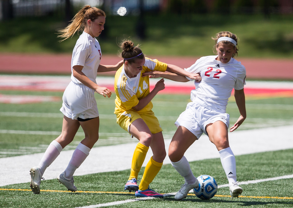 Glenwood's Maggie Juhlin (22) steals the ball away from Mundelein Carmel's McKenzie Runyan (14) in the second half during the IHSA Class 2A Girls State Soccer Championship at North Central College, Saturday, June 6, 2015, in Naperville, Ill. Justin L. Fowler/The State Journal-Register