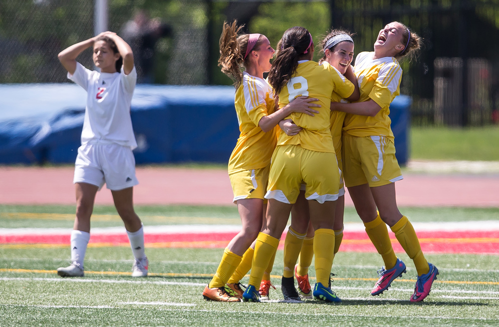 Mundelein Carmel's Erin Johnston (3) is swarmed by her teammates after scoring a goal to put the team up 1-0 against Glenwood with only 2 min and 30 seconds left in the second half during the IHSA Class 2A Girls State Soccer Championship at North Central College, Saturday, June 6, 2015, in Naperville, Ill. Justin L. Fowler/The State Journal-Register