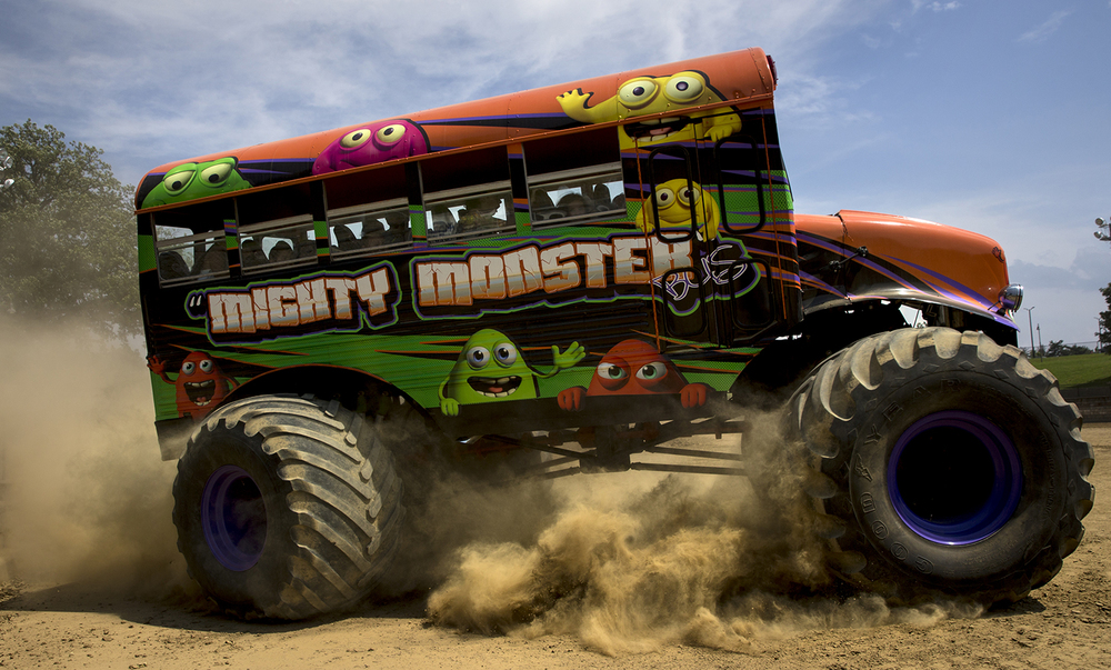 """Mighty Monster,"" a monster truck passenger bus that provides paid rides, slides around a corner at the Lucas Oil Monster Truck Nationals at the Multi-Purpose Arena at the Illinois State Fairgrounds Sunday, June 6, 2015.  Ted Schurter/The State Journal-Register"