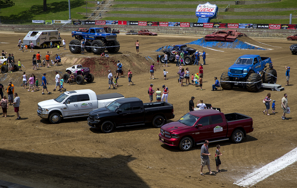 Fans mill about the different vehicles on display before the official start of the Lucas Oil Monster Truck Nationals at the Multi-Purpose Arena at the Illinois State Fairgrounds Sunday, June 6, 2015.  Ted Schurter/The State Journal-Register
