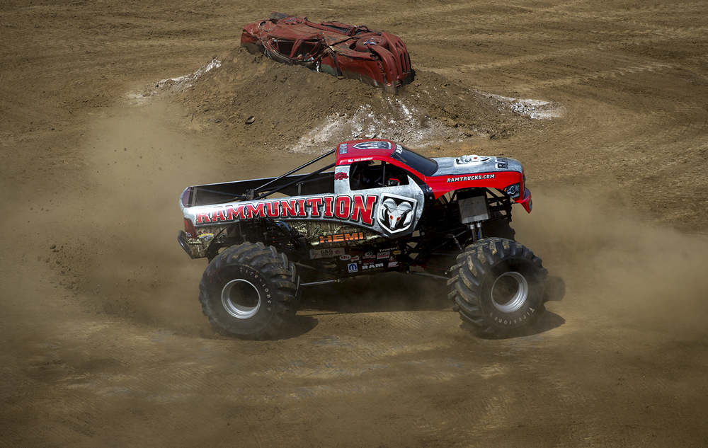 The monster truck Rammunition spits dirt as it turns donuts at the Lucas Oil Monster Truck Nationals at the Multi-Purpose Arena at the Illinois State Fairgrounds Sunday, June 6, 2015. Ted Schurter/The State Journal-Register