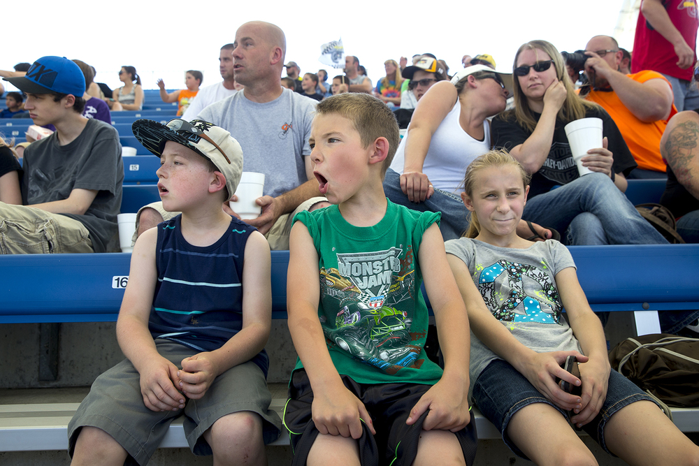 Casey Carter, Wyatt Brown and Kayle Taylor react as monster trucks perform wheelies at the Lucas Oil Monster Truck Nationals at the Multi-Purpose Arena at the Illinois State Fairgrounds Sunday, June 6, 2015. Ted Schurter/The State Journal-Register