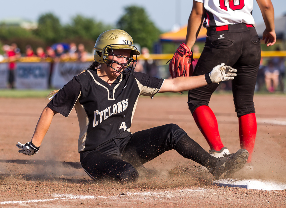 Sacred Heart-Griffin's Katie McLean (4) slides safely into third base on a triple in the 7th inning against Highland during the Class 3A Springfield Supersectional at the Land of Lincoln Junior Olympic Softball Complex at UIS, Tuesday, June 9, 2015, in Springfield, Ill. Justin L. Fowler/The State Journal-Register