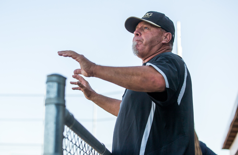 Sacred Heart-Griffin head coach Al Yoho calls out instructions to his team in the 7th inning as they take on Highland during the Class 3A Springfield Supersectional at the Land of Lincoln Junior Olympic Softball Complex at UIS, Tuesday, June 9, 2015, in Springfield, Ill. Justin L. Fowler/The State Journal-Register
