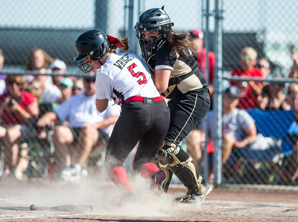 Sacred Heart-Griffin catcher MaKenna Butcher (44) tags out Highland's Lauren Wright (5) at home plate during the Class 3A Springfield Supersectional at the Land of Lincoln Junior Olympic Softball Complex at UIS, Tuesday, June 9, 2015, in Springfield, Ill. Justin L. Fowler/The State Journal-Register