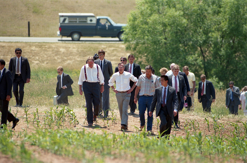 Vice President George H.W. Bush, center, Gov. Jim Thompson and Raymond Poe walk into a drought stricken corn field on Andrew Road near Sherman June 18, 1988. File/Rich Saal/The State Journal-Register